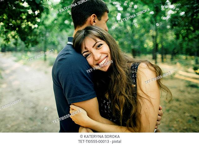 Young couple embracing in park