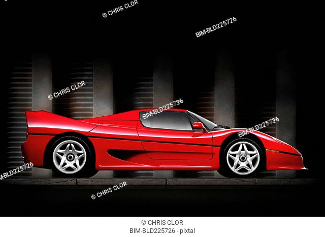 Side view of shiny red sports car