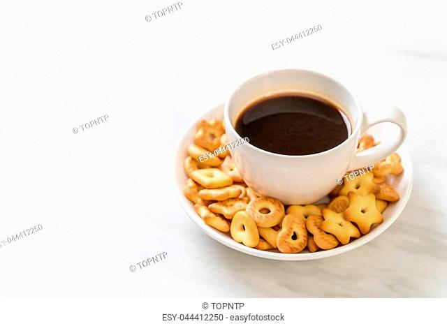 biscuits cracker with coffee on table
