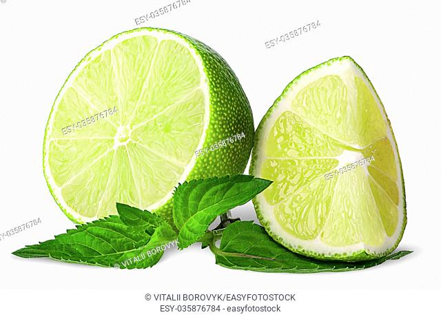 Several pieces of lime with mint isolated on white background