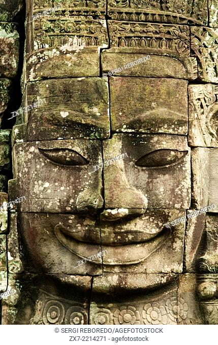 The faces of the Bayon temple. Angkor Thom. Angkor Thom was built as a square, the sides of which run exactly north to south and east to west