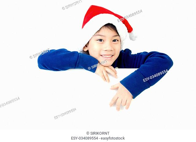 Portrait of Asian cute boy in christmas hat with blank space for your text