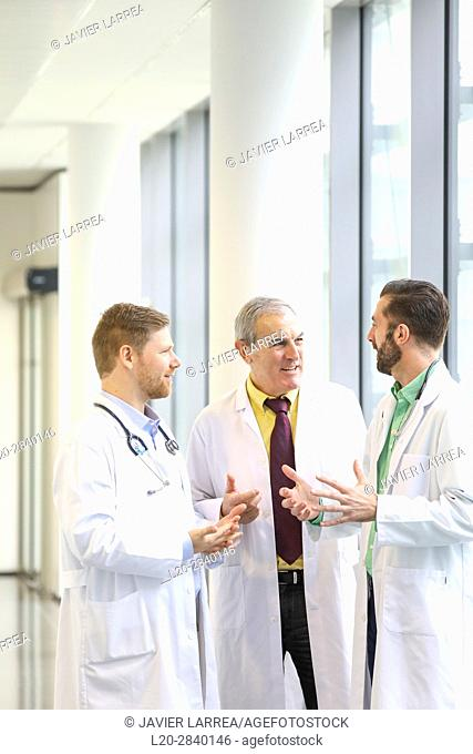 Doctors talking in corridor, Hospital