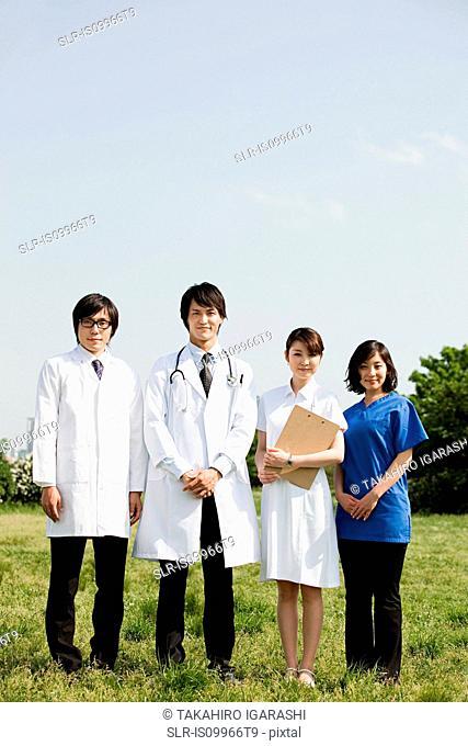 Male doctors and female nurses in field