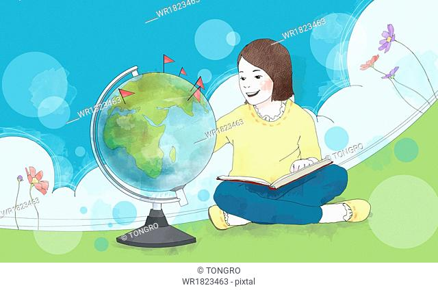 a girl playing with the globe