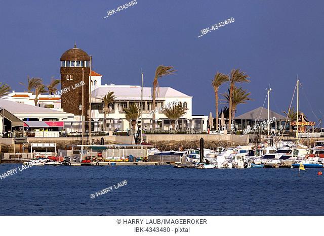 Marina and sidewalk cafe in El Castillo or Caleta de Fuste, Fuerteventura, Canary Islands, Spain
