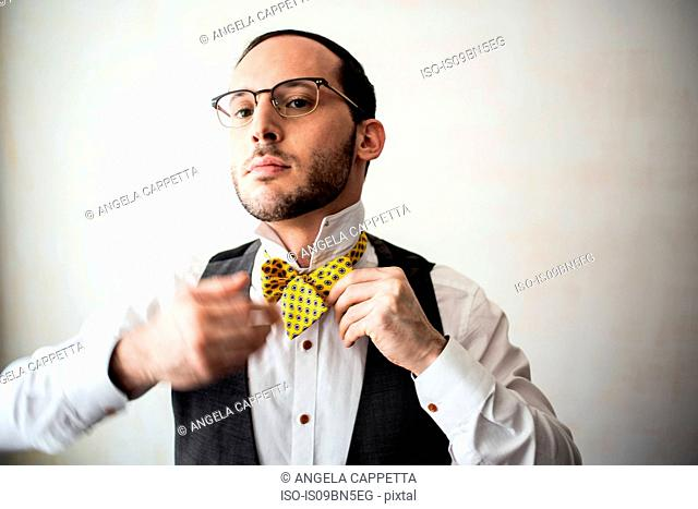 Businessman putting on bow tie