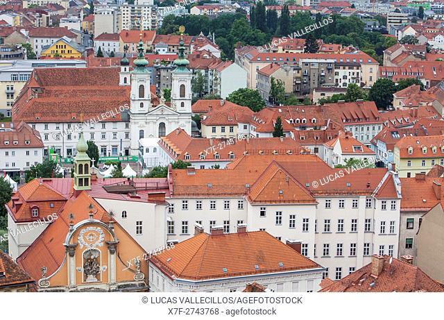 Aerial view, church of Minorites and the orange facade of Dreifaltigkeitskirche or Holy Trinity church, Graz, Austria