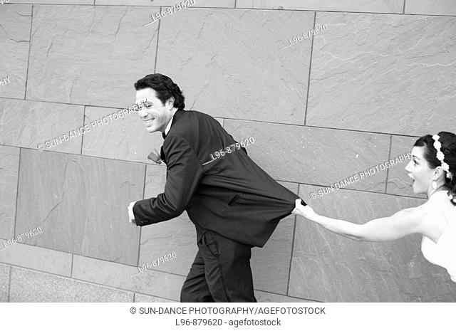having fun, groom running away from bride