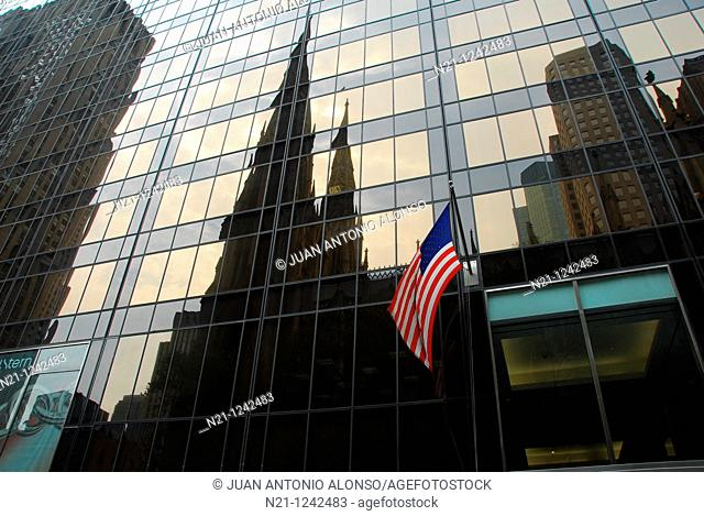 Saint Patrick's Cathedral reflected on the Olimpic Tower. New York, New York. USA