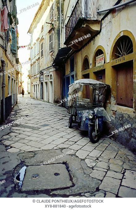 Lane and motorcycle. Corfu. Greece