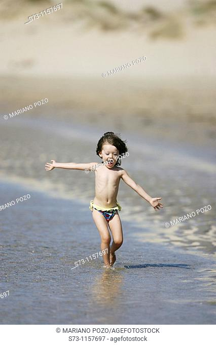 3 year old girl on beach