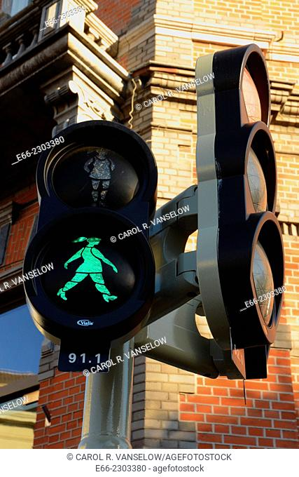 Traffic signal at intersection in Maastricht. Signalling that it is okay to walk