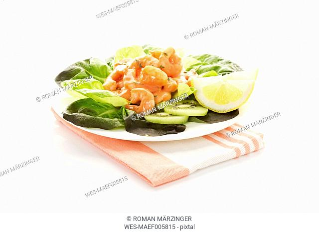 Plate of shrimps cocktail on white background, close up