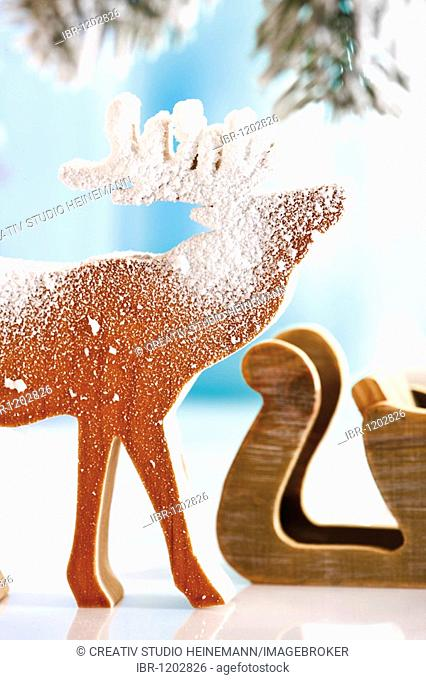 Moose, reindeer, made of wood, covered with snow, Christmas decoration