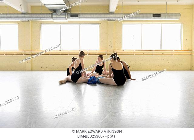 Girls sitting on floor of ballet studio