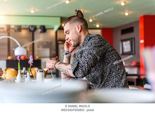 Stylish young man in a cafe