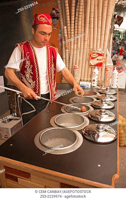 Ice cream vendor with traditional clothing in town center, Bodrum, Mugla, Aegean Sea, Turkish Riviera, Turkey, Europe