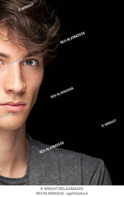 Teenager male boy portrait serious angry close up