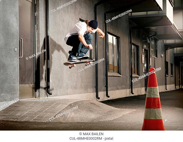 Skater jumping on urban ramp