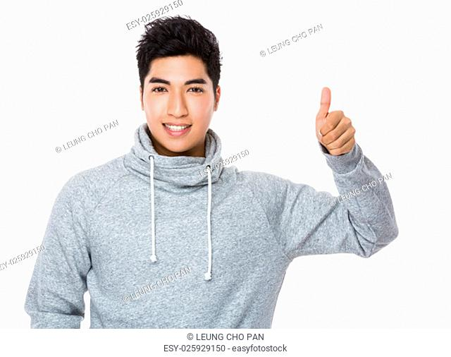 Young man showing thumb up gesture