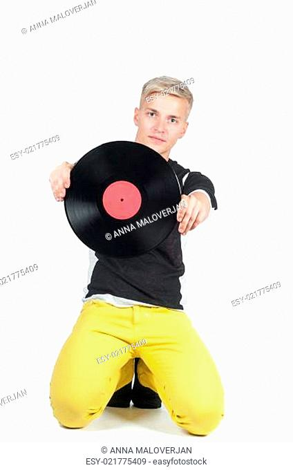 Young man showing from vinyl record
