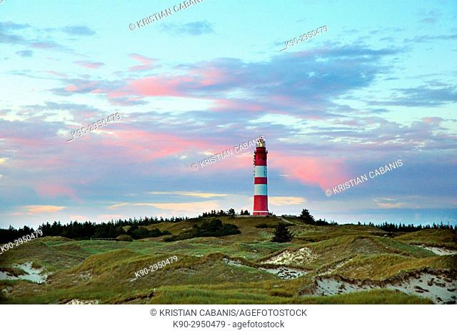 Lighthouse of the island of Amrum with illuminated evening clouds, Northfrisian Islands, Schleswig-Holstein, Germany, Europe