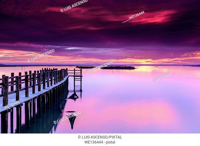 Mourisca sunrise, Sado river, Mourisca tidal mill, pier stilts in wood, Portugal, Setúbal, high tidal