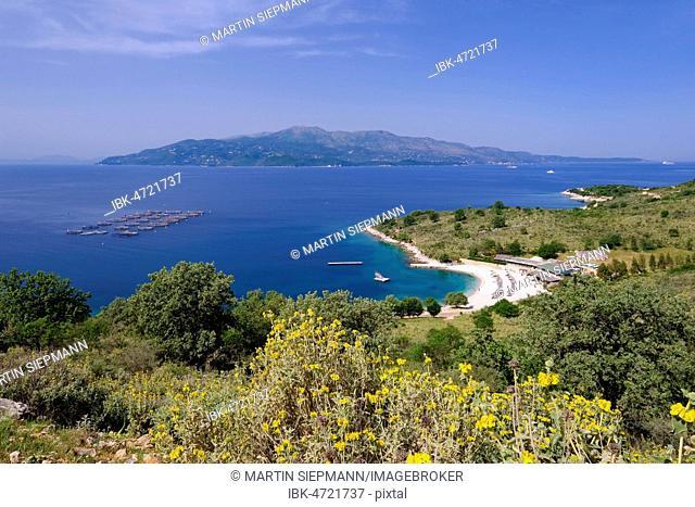 Coast with beach Gjiri i Hartes, behind the Greek island of Corfu, National Park Butrint, between Ksamil and Saranda, Sarandë, Ionian Sea, Qark Vlora, Albania