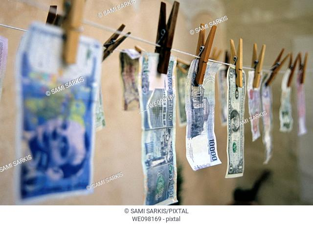 International banknotes drying on a washing line