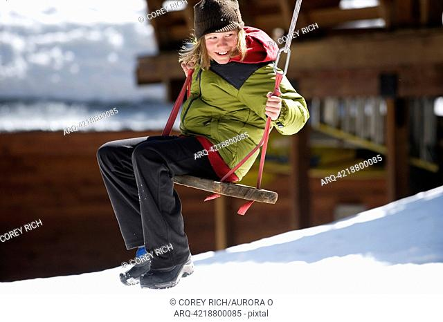 A boy plays outside in Lake Tahoe, California