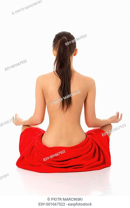 Young beautiful woman meditating
