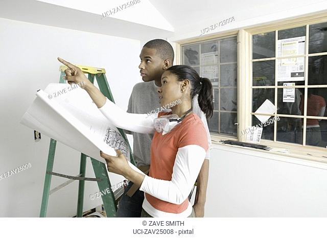African couple discussing plants for unfinished room