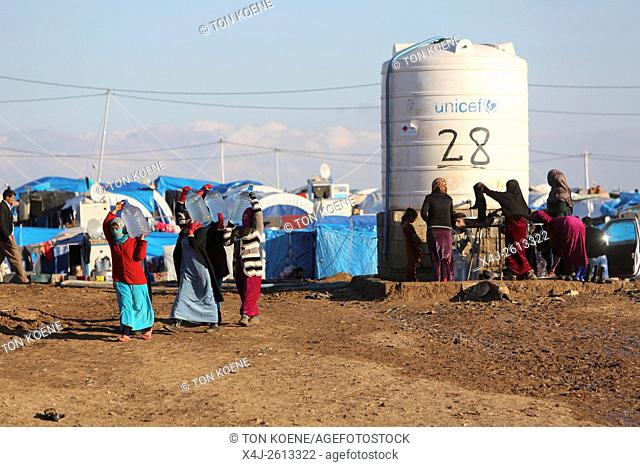 Refugees fetching water in a refugee camp in Northern Iraq