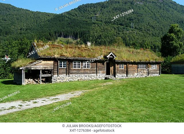 A traditionally built long house in Stordal Norway with a grass roof