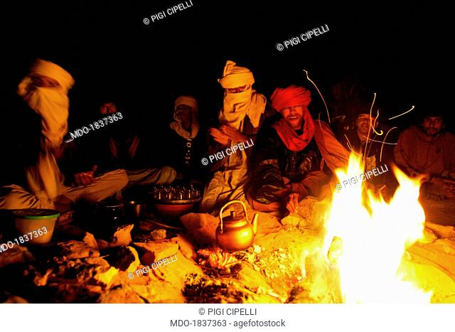 Tuareg of the Libyan Desert around a bonfire