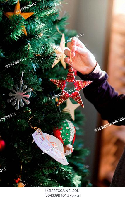 Child putting up Christmas decorations