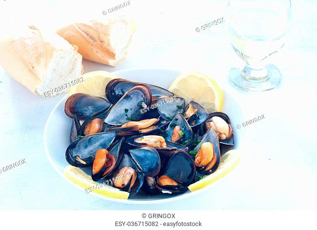 Cooked mussels marinara with tomato, garlic and olive oil, italy