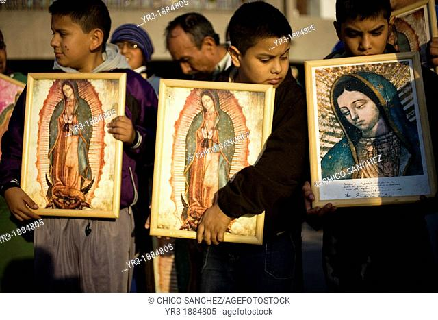Young pilgrims carry an image of the Our Lady of Guadalupe outside of the Our Lady of Guadalupe Basilica in Mexico City, December 9, 2012