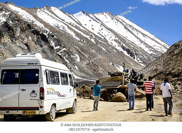 Fixing the main Khardung La road after a landslide. This happens daily on that route