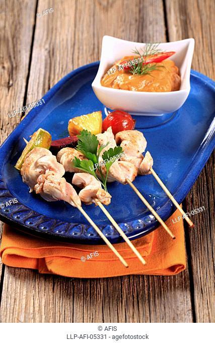 Chicken skewers and Romesco sauce