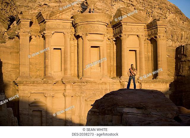 A Woman Tourist Visits The Nabatean Ruins Of The Monastery, Petra Jordan