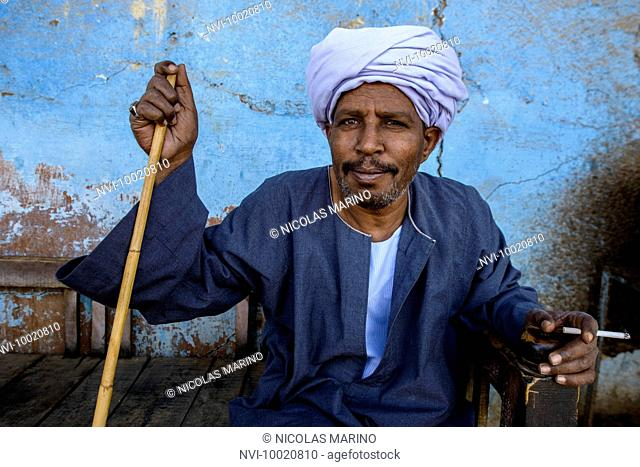 Man hanging out at teahouse near Aswan, Egypt
