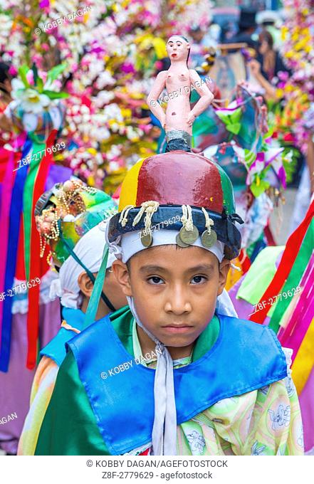 Salvadorian people participate in the procession of the Flower & Palm Festival in Panchimalco, El Salvador