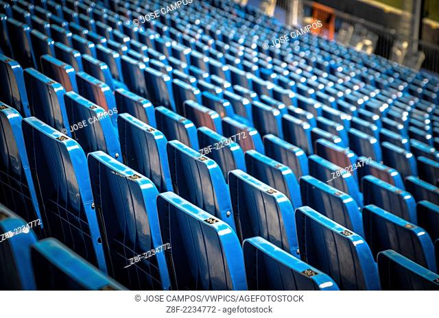 Plastic blue seats in Santiago Bernabeu Stadium. All-seater football stadium in Madrid, Spain. It was inaugurated on 14 December 1947 and is owned by Real...