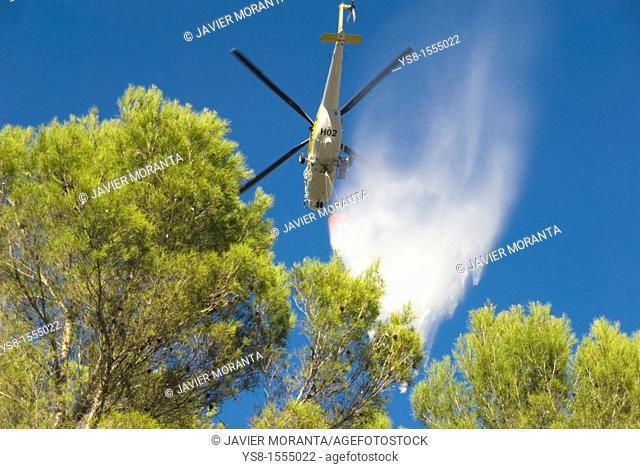 Spain, Balearic Islands, Mallorca, Helicopter stifling wildfire