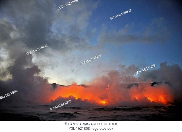 Steam rising off lava flowing into ocean at dusk, Kilauea Volcano, Big Island, Hawaii Islands, USA