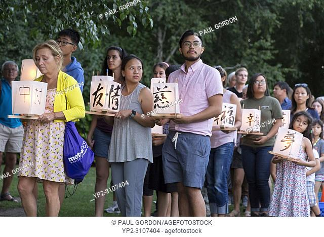 Seattle, Washington: Participants line up with paper lanterns at the From Hiroshima To Hope gathering at Green Lake Park