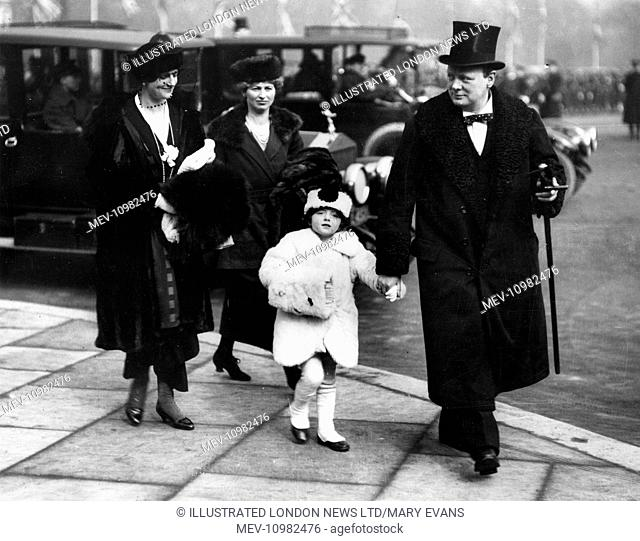 Mr and Mrs Winston Churchill and their little daughter at the march past of the guards at Buckingham Palace. The date of the photograph is marked on the back as...