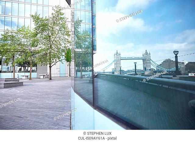 Tower Bridge reflected in glass window, London, England, UK